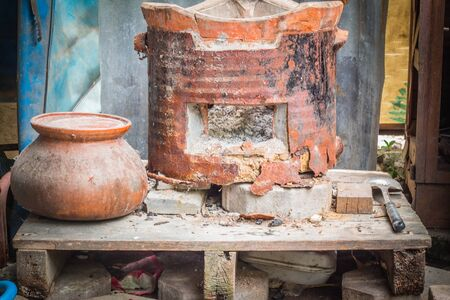 clay pot: Charcoal and old clay pot of countryside. Stock Photo