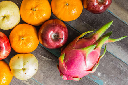 wooden floors: Colorful variety of fruits on wooden floors. Stock Photo