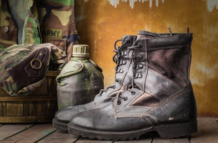 military watch: Military boots on a wooden