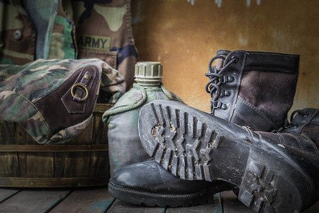 army boots: boots of soldiers placed on a wooden Stock Photo