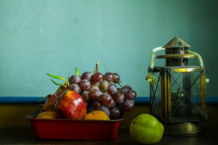 oldstyle: Fruit and plenty of old-style on the table.