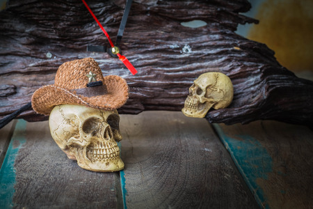 skull cap: The skull cap and an old wooden clock.