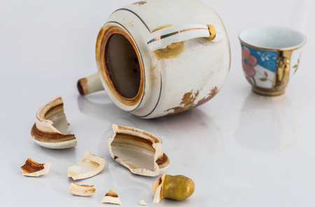 Tea lid debris that falls apart on a white background.