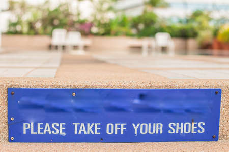 inground: Warning sign on the entrance stairs pool. Stock Photo