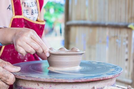 making earth: Hand made 0f clay pot shape.