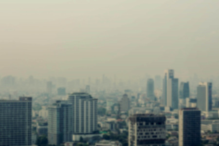 work places: Buildings and work places in the city with hazy sky.
