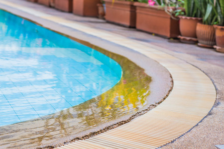 inground: The surface of the edge of the pool. Editorial