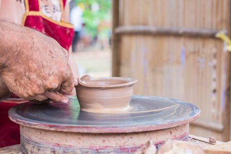 Hand made clay pot bending shape.