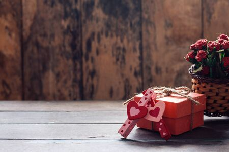 pink and red heart shaped and gift box on a wooden table. Stock Photo