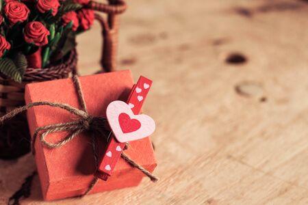 uprzejmości: Heart-shaped on gift boxes with wooden floors. Zdjęcie Seryjne