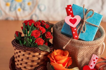 Heart-shaped and gift box with flowers on the basket. Zdjęcie Seryjne