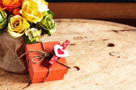 flirtation: Gifts and bouquets of flowers on the wooden. Stock Photo