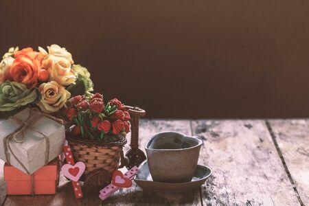uprzejmości: Gifts and cup on the old wooden floor. Zdjęcie Seryjne
