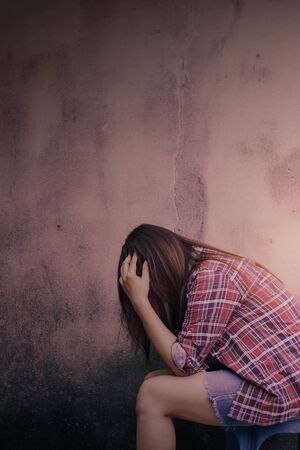repress: Women with stress side a walls