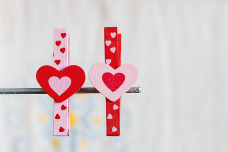 Colorful hearts on a white background with a metal bar.