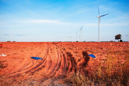 Wheel track on a ground with the blue sky. Stock Photo