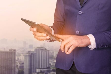 tiedup: Businessmen are using tablets in urban society.