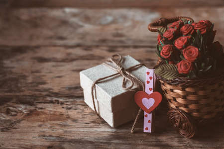 Heart and gift boxes on the old wooden floor. Zdjęcie Seryjne