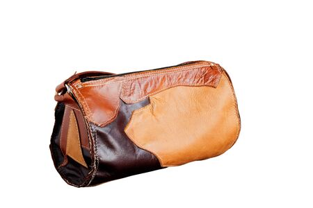 documented: Brown leather bag on a white background. Stock Photo