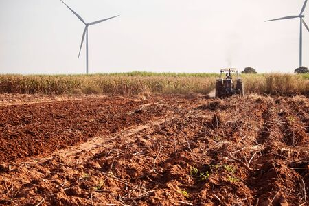 dirtied: ground where the farmer is plowing soil for crops.