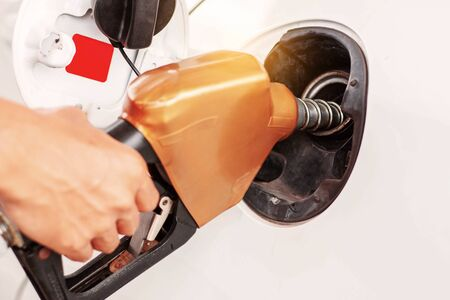 Hands of male employees are fueling cars. Stock Photo