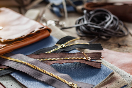Zip and leather repairing equipment on the table.