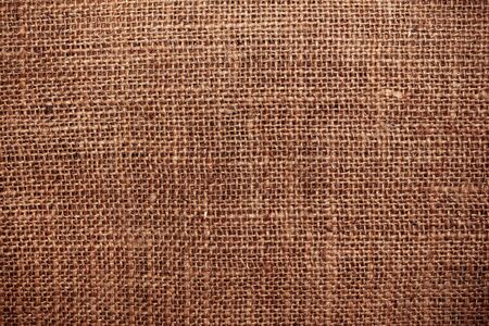 brown flax: Textures and details the background of sackcloth.