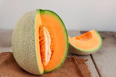 sliced watermelon: Colorful of melon cut on wooden floor.