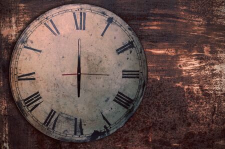 horologe: Antique clock on the old iron and rusty. Stock Photo