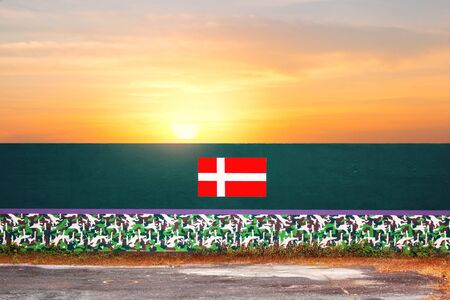 England flag on a concrete wall with sky at sunset. Stock Photo