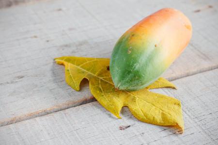 Papaya on the old wooden floor.