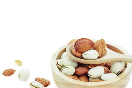 Almond in a bowl on white background. Stock Photo