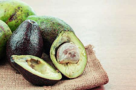 Ripe fruit of avocado on sack.
