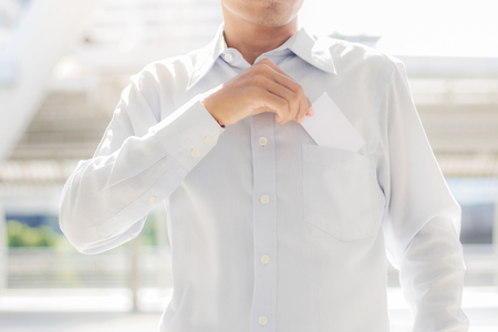 Businessman is taking a business card from his pocket.