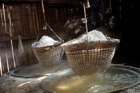 Ancient method of boiling brine into pure salt in Bo Kluea of Thailand. Stok Fotoğraf