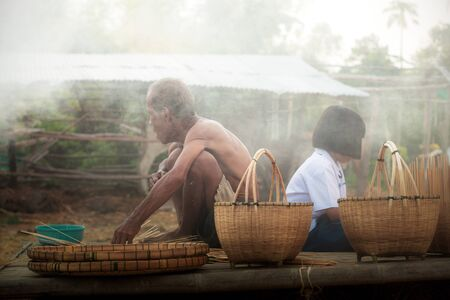 Old men and girls in rural of Thailand.