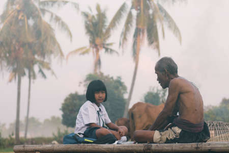 Old man and girl of Thailand in the countryside.