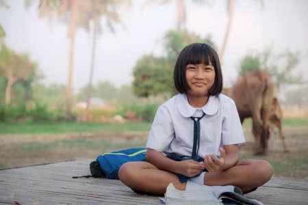 Children of schoolgirl in the countryside.
