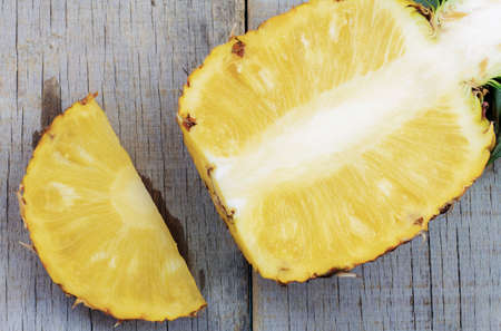 Pineapple cut on the old wooden floor.