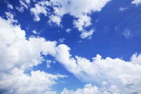 White clouds in the blue sky with background.