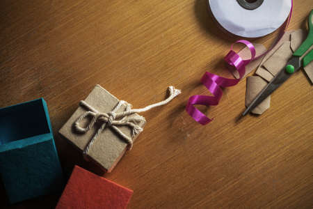 Gift box and ribbon on the old wooden floor.
