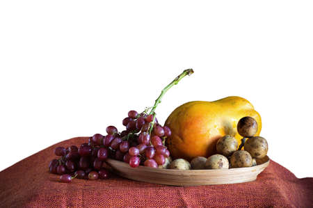 Grapes and fruits on tray with a white background.