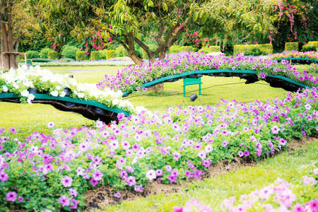 Flower garden with decorations in the high season.