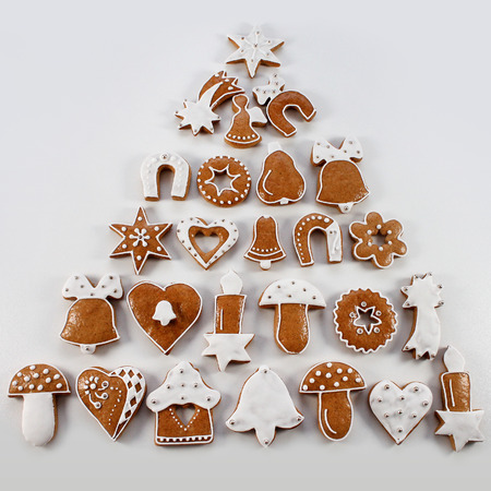 hause: Christmas gingerbread handmade in the form of a Christmas tree - Stock Photo # 80677176 Christmas gingerbread handmade with white icing in the form of a Christmas tree