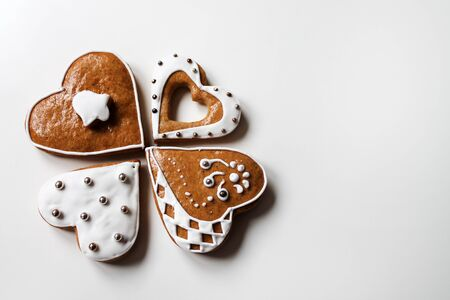 charity collection: Christmas gingerbread heart-shaped on white background