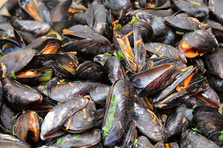 prepared shellfish: A background of mussels for sale at a fish market