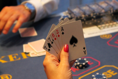 knave: Casino.Playing cards in hand