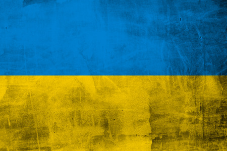 polity: Grunge flag of Ukraine on the concrete wall Stock Photo