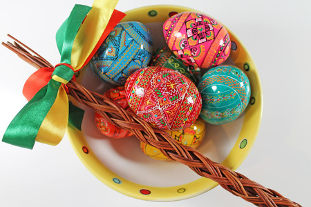 Traditional czech Wicker whip and easter eggs. Traditional easter decoration.