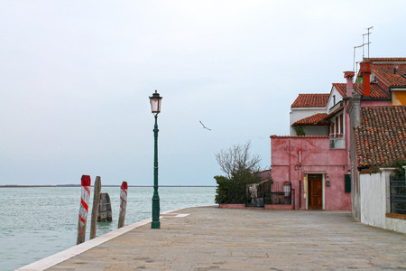 Pier on Burano island near Venice. Italy, Europe.